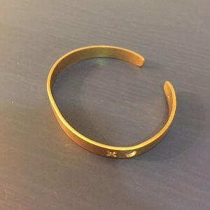 Gold bangle with XO cut outs
